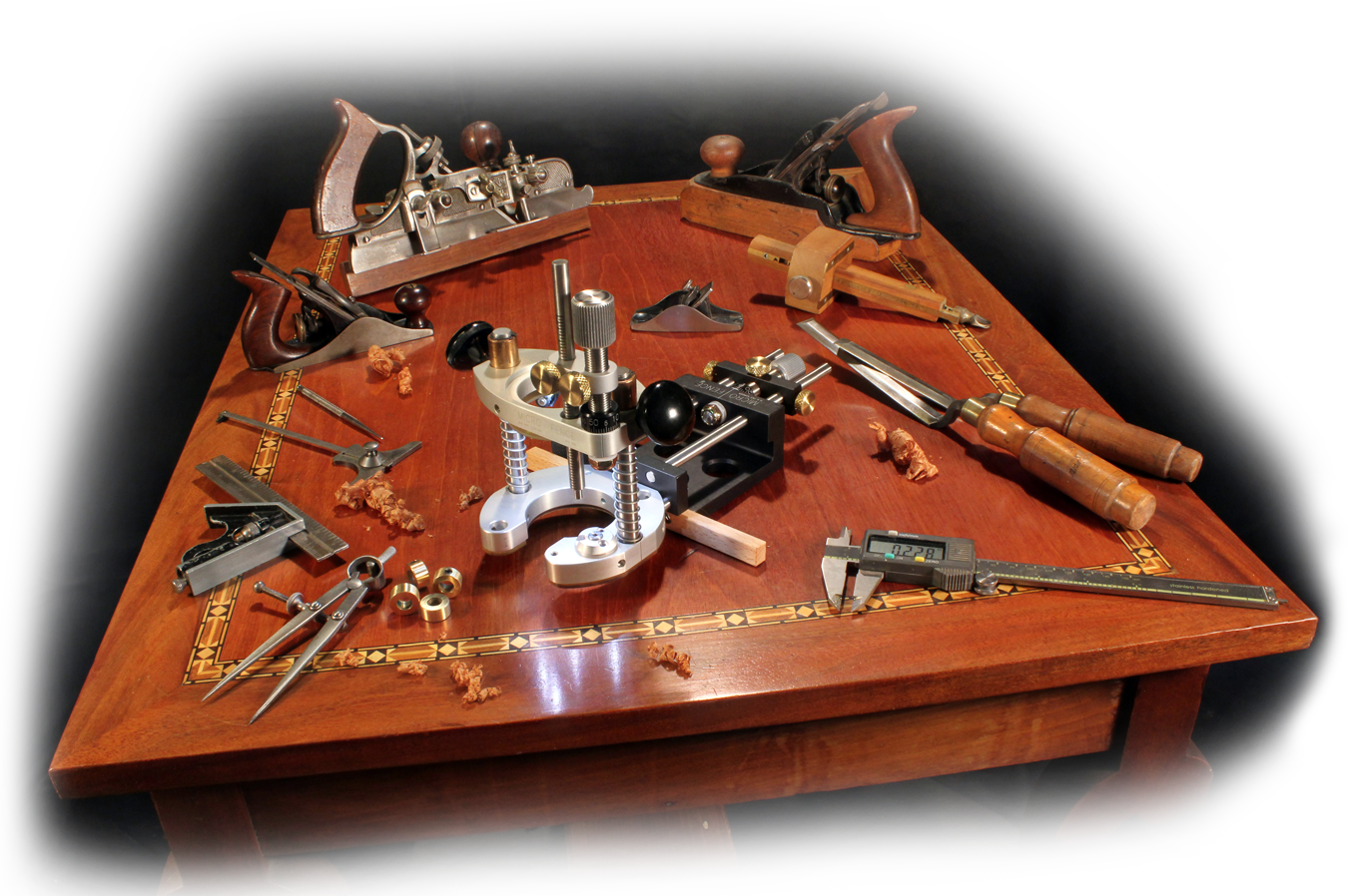 A display of multiple woodworking tools, from classic to modern, with black background.